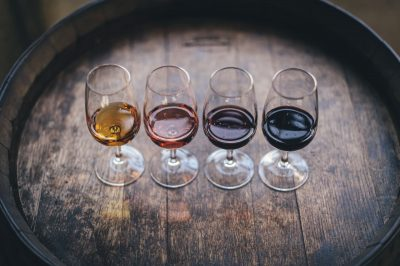4 glasses of wine in colorful flavors