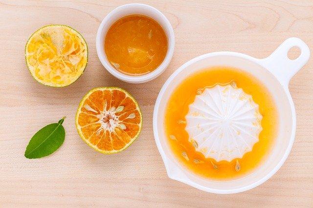 fresh orange juice in citrus juicer