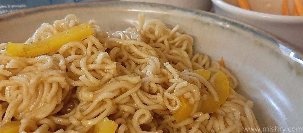 closer look at cooked little millet noodles in a plate