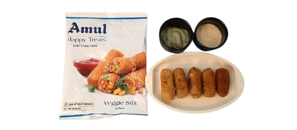 cooked veggie stix in a plate ready to eat with mayonnaise and sauce