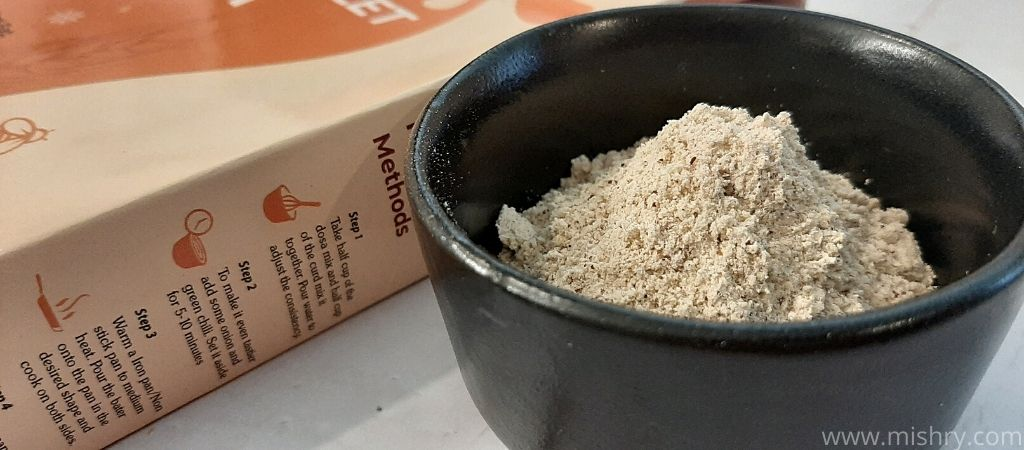 multi millet dosa packet contents in a bowl